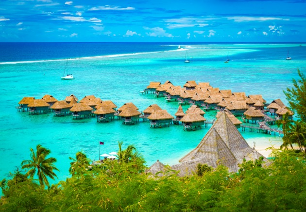 French Polynesia hotel resort island image over water bungalows