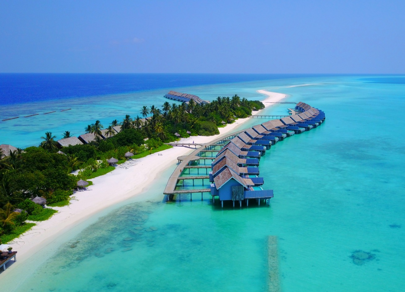 Tropical Maldivian resort, with traditional water bungalows