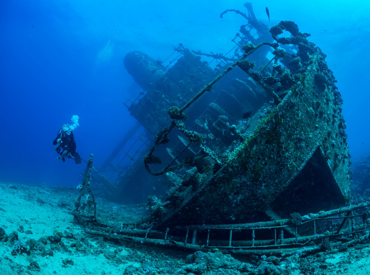 Scuba diver inspects the Giannis D wreck in the Red Sea, Egypt