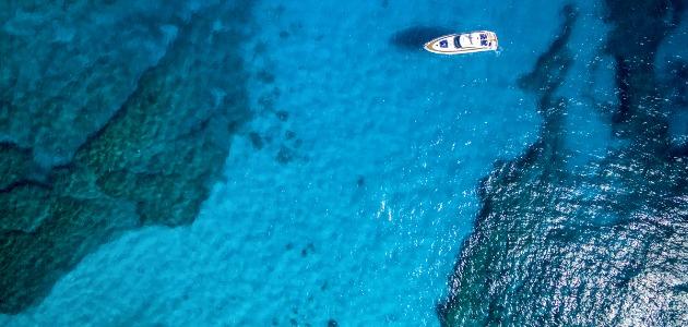 Boat sailing around the Maldives atolls