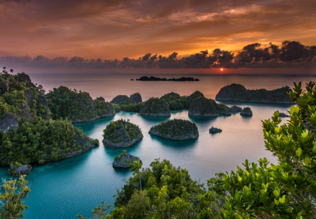 Aerial view of the sun setting over Indonesia islands